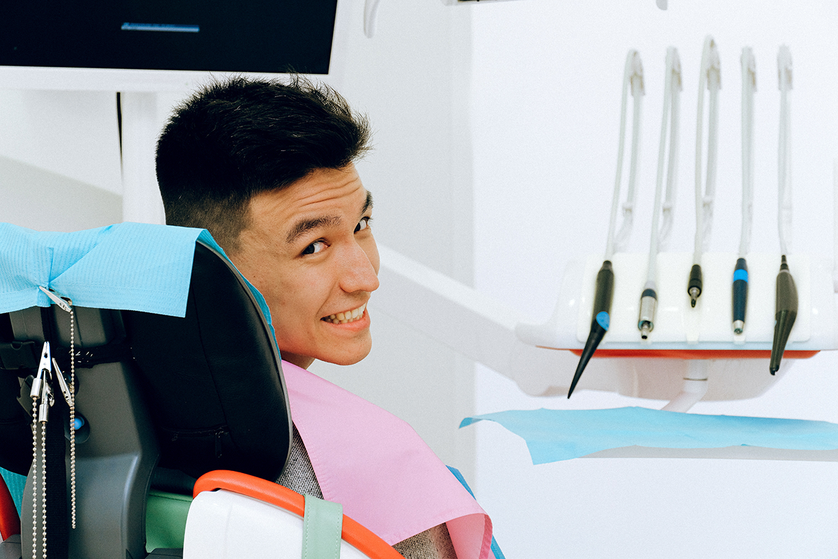 smiling guy in dentist chair